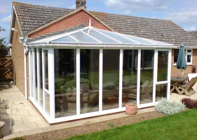 Conservatory finished with a light neutral film to stop heat, glare and fading
